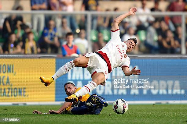 Stephan El Shaarawy of AC Milan competes the ball with Alessandro Agostini of Hellas Verona FC during the Serie A match between Hellas Verona FC and...