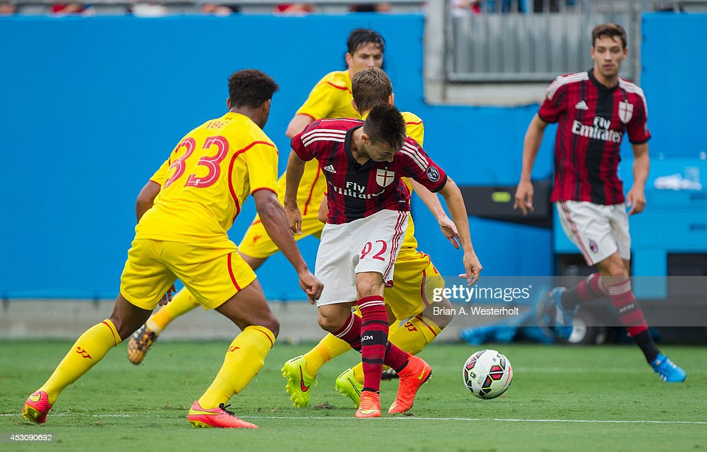 Stephan El Shaarawy #92 of A.C. Milan fights for the ball with Jordon Ibe #33 of Liverpool during first half action in the Guinness International Champions Cup at Bank of America Stadium on August 2, 2014 in Charlotte, North Carolina. Liverpool defeated A.C. Milan 2-0.