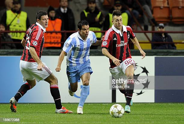 Stephan El Shaarawy of AC Milan in action against Javier Saviola of Malaga CF during the UEFA Champions League group C match between AC Milan and...