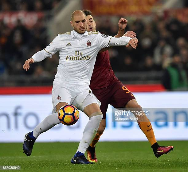 Stephan El Shaarawy of AS Roma and Gabriel Paletta of AC Milan in action during the Serie A match between AS Roma and AC Milan at Stadio Olimpico on...