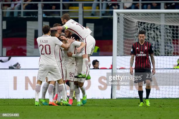 Stephan El Shaarawy of AS Roma celebrates with his teammates after scoring a goal during the Serie A football match between AC Milan and AS Roma AS...