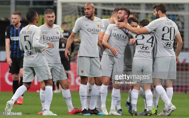 Stephan El Shaarawy of AS Roma celebrates with his teammates after scoring the opening goal during the Serie A match between FC Internazionale and AS...