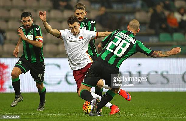 Stephan El Shaarawy of AS Roma competes for the ball with Paolo Cannavaro of US Sassuolo Calcio during the Serie A match between US Sassuolo Calcio...