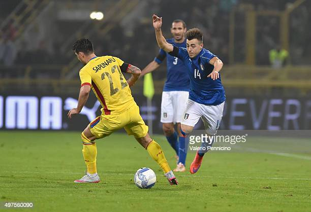 Stephan El Shaarawy of Italy and Cristian Sapunaru of Romania compete for the ball during the international friendly match between Italy and Romania...