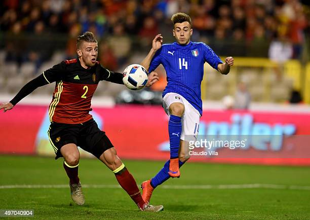Stephan El Shaarawy of Italy and Toby Alderweireld of Belgium compete for the ball during the intermational friendly match between Belgium and Italy...