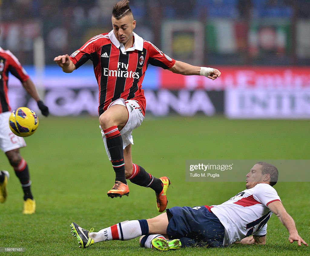 Stephan El Shaarawy (L) of Milan jumps as Diego Perez of Bologna tackles during the Serie A match between AC Milan and Bologna FC at San Siro Stadium on January 20, 2013 in Milan, Italy.