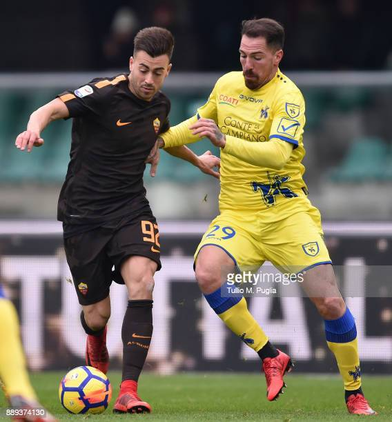 Stephan El Shaarawy of Roma and Fabrizio Cacciatore of Chievo Verona compete for the ball during the Serie A match between AC Chievo Verona and AS...