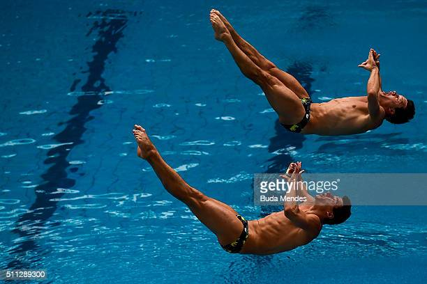 Stephan Feck and Patrick Hausding of Germany compete in the men's 3m synchro springboard preliminary as part of the 2016 FINA Diving World Cup at...