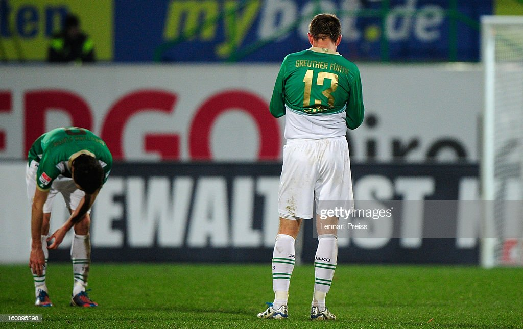 Stephan Fuerstner and Milorad Pekovic of Fuerth stand on the pitch after the Bundesliga match between SpVgg Greuther Fuerth and 1. FSV Mainz 05 at Trolli-Arena on January 26, 2013 in Fuerth, Germany.