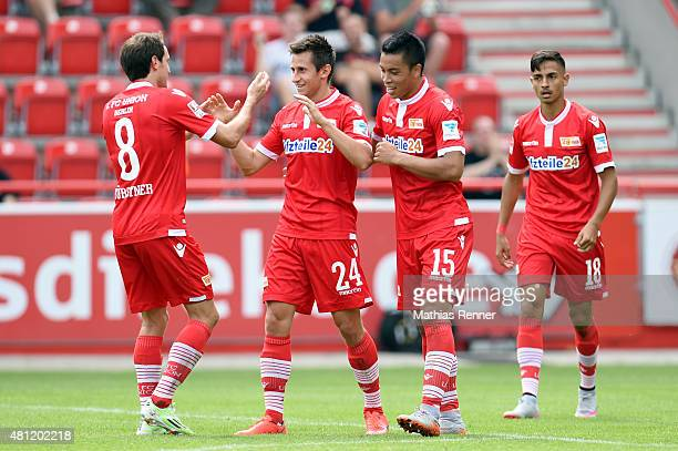 Stephan Fuerstner Steven Skrzybski Bobby Wood and Kenny Prince Redondo of 1 FC Union Berlin celebrate after scoring a goal to make it 20 during the...