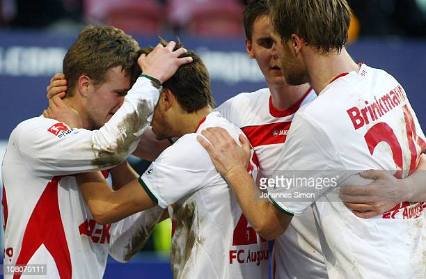 Stephan Hain of Augsburg celebrates with his teammates after scoring his team's second goal during the Second Bundesliga match between FC Augsburg v...