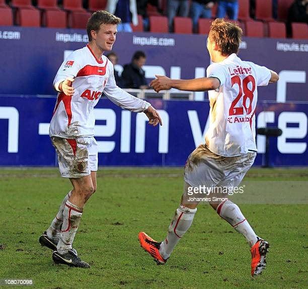 Stephan Hain of Augsburg celebrates with teammate Moritz Leitner after scoring his team's second goal during the Second Bundesliga match between FC...