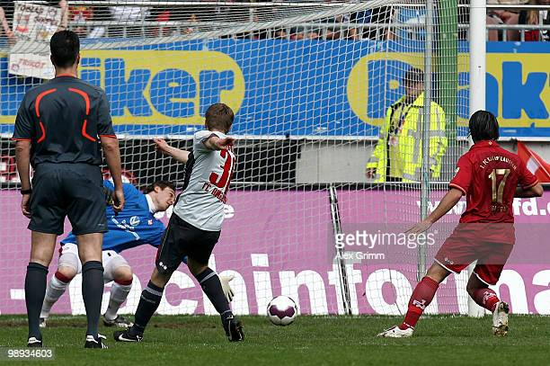 Stephan Hain of Augsburg scores his team's first goal during the Second Bundesliga match between 1. FC Kaiserslautern and FC Augsburg at the...
