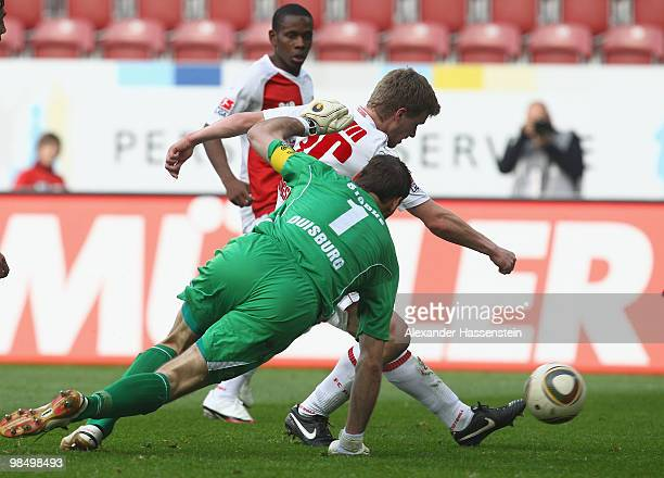 Stephan Hain of Augsburg scores the opening goal against keeper Tom Starke of Duisburg during the Second Bundesliga match between FC Augsburg and MSV...