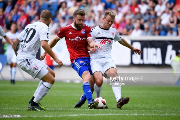 Stephan Hain of Haching and Connor Krempicki of KFC Uerdingen battle for the ball during the 3 Liga match between KFC Uerdingen 05 and SpVgg...