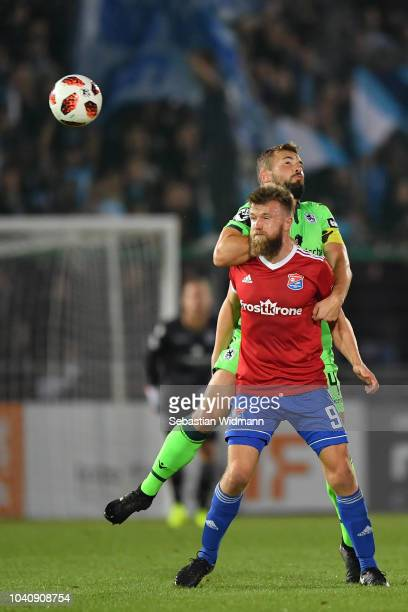 Stephan Hainof Unterhaching and Felix Weber of 1860 Muenchen compete for the ball during the 3. Liga match between SpVgg Unterhaching and TSV 1860...