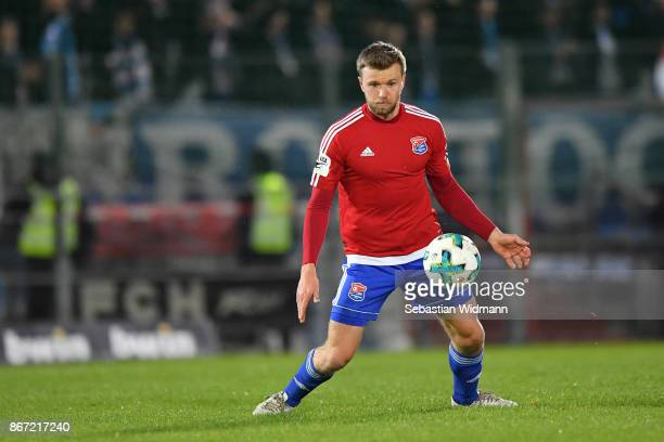 Stephan Hain of Unterhaching plays the ball during the 3 Liga match between SpVgg Unterhaching and FC Hansa Rostock at Alpenbauer Sportpark on...