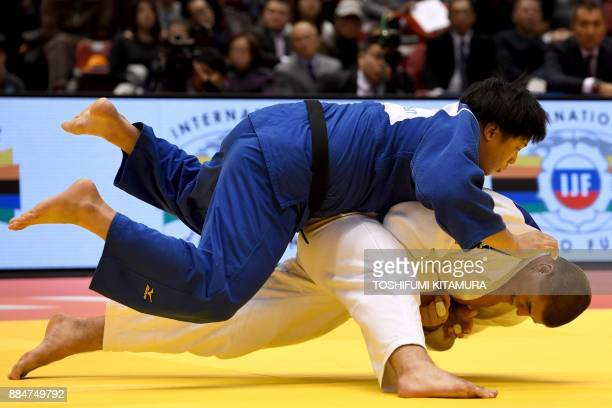 TOPSHOT Stephan Hegyi of Austria fights with Kokoro Kageura of Japan during their men's over 100kg category bronze medal final match of the Judo...