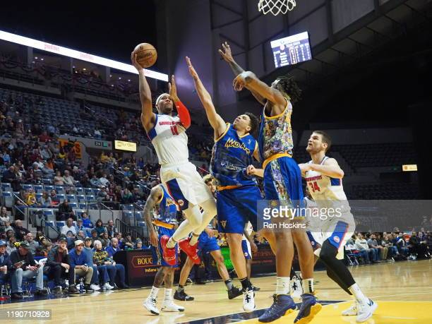 Stephan Hicks and Travin Thidodeaux of the Fort Wayne Mad Ants battle Tre'Shawn Thurman of the Grand Rapids Drive on December 28 2019 at Memorial...