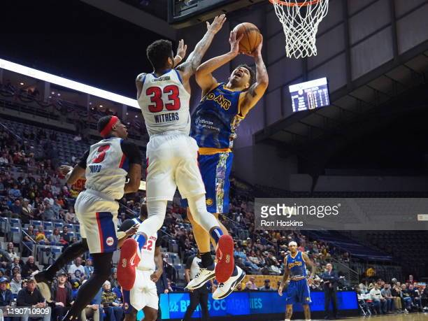 Stephan Hicks of the Fort Wayne Mad Ants battles Todd Withers of the Grand Rapids Drive on December 28 2019 at Memorial Coliseum in Fort Wayne...