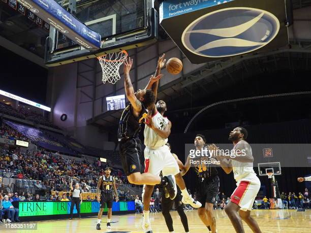 Stephan Hicks of the Fort Wayne Mad Ants blocks the shot again Vito Brown of the Erie Bayhawks on December 13 2019 at Memorial Coliseum in Fort Wayne...