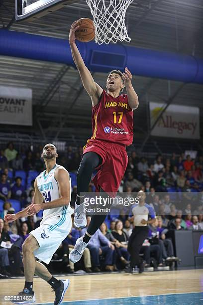Stephan Hicks of the Fort Wayne Mad Ants drives to the basket against Perry Ellis of the Greensboro Swarm at the The Field House at the Greensboro...