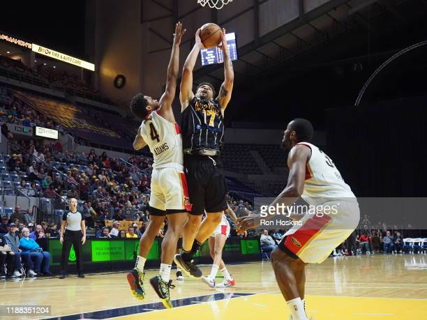 Stephan Hicks of the Fort Wayne Mad Ants handles the ball against Jalen Adams of the Erie Bayhawks on December 13 2019 at Memorial Coliseum in Fort...