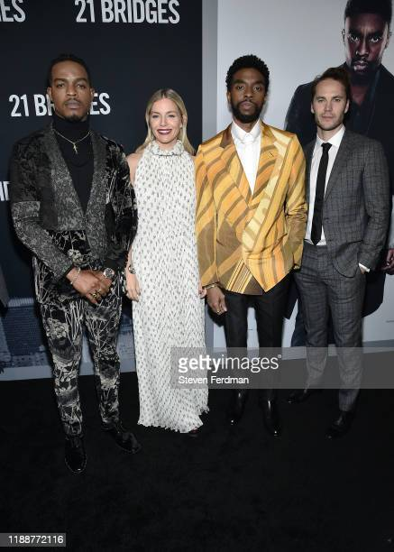 Stephan James Sienna Miller Chadwick Boseman and Taylor Kitsch attend 21 Bridges New York Screening at AMC Lincoln Square Theater on November 19 2019...