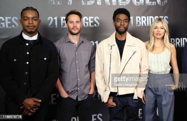 Stephan James Taylor Kitsch Chadwick Boseman and Sienna Miller attend a photocall for STX Entertainment's 21 Bridges at Four Seasons Hotel Los...