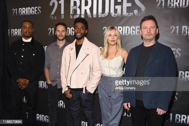 Stephan James Taylor Kitsch Chadwick Boseman Sienna Miller and Brian Kirk attend the photocall for STX Entertainment's 21 Bridges at Four Seasons...