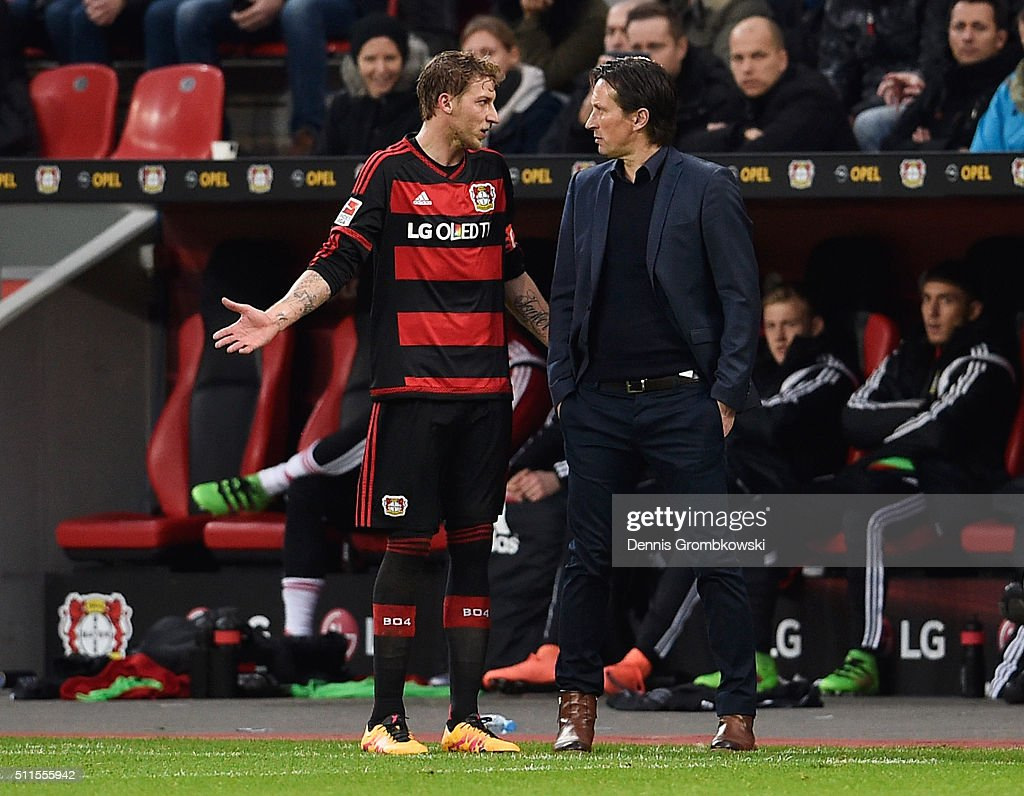 Stephan Kiessling of Bayer Leverkusen in discussion with Roger Schmidt head coach of Bayer Leverkusen during the Bundesliga match between Bayer Leverkusen and Borussia Dortmund at BayArena on February 21, 2016 in Leverkusen, Germany.