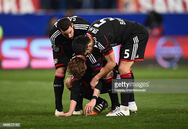 Stephan Kiessling of Bayer Leverkusen is consoled by team mates after missing the last penalty in the shoot out during the UEFA Champions League...