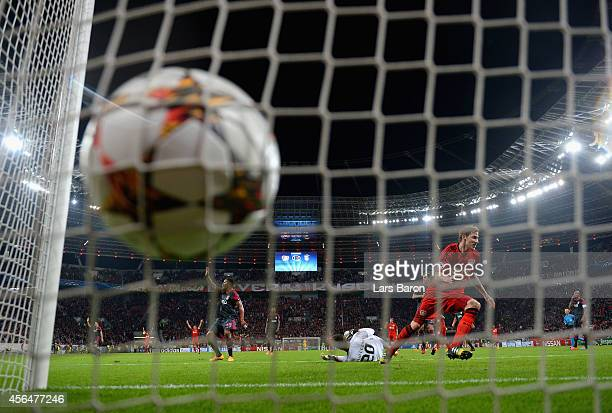 Stephan Kiessling of Bayer Leverkusen turns to celebrate scoring the opening goal during the UEFA Champions League Group C match between Bayer 04...