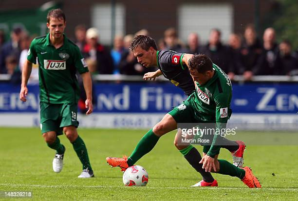 Stephan Kuehne of Muenster and Patrick Herrmann of Gladbach battle for the ball during the friendly match between Preussen Muenster and Borussia...