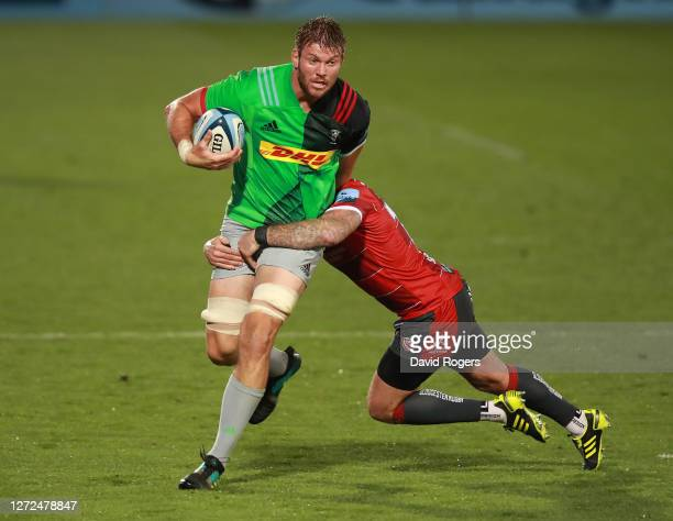 Stephan Lewies of Harlequins is tackled by Danny Cipriani during the Gallagher Premiership Rugby match between Gloucester Rugby and Harlequins at...