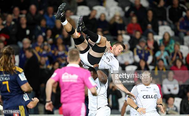 Stephan Lewies of the Sharks is held up by his teammate Tendai Mtawarira to secure the kickoff during the round 12 Super Rugby match between the...