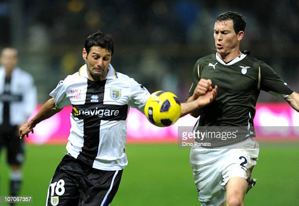 Stephan Lichesteiner of Lazio competes with Massimo Gobbi of Parma during the Serie A match between Parma and Lazio at Stadio Ennio Tardini on...