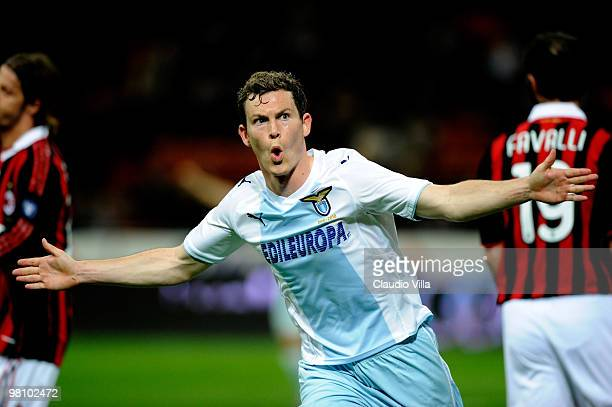 Stephan Lichsteiner of SS Lazio celebrates a goal during the Serie A match between AC Milan and SS Lazio at Stadio Giuseppe Meazza on March 28 2010...