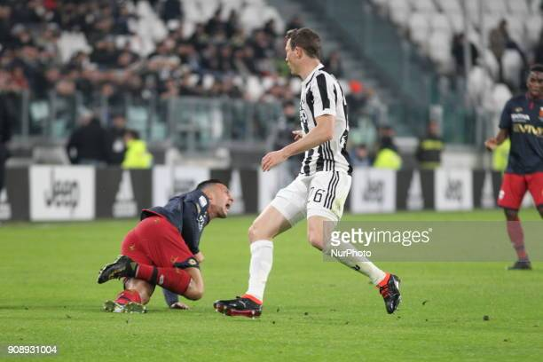 Stephan Lichtsteiner and Armando Izzo during the Serie A football match between Juventus FC and Genoa CFC at Allianz Stadium on 22 January 2018 in...