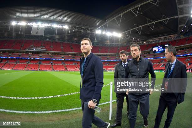 Stephan Lichtsteiner and Claudio Marchisio of Juventus during the UEFA Champions League Round of 16 Second Leg match between Tottenham Hotspur and...
