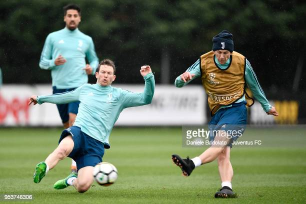 Stephan Lichtsteiner and Federico Bernardeschi during the Juventus training session at Juventus Center Vinovo on May 2 2018 in Vinovo Italy
