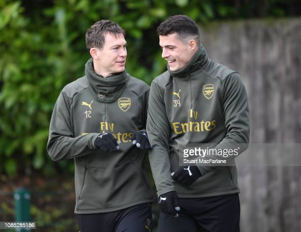 Stephan Lichtsteiner and Granit Xhaka of Arsenal during a training session at London Colney on December 21 2018 in St Albans England
