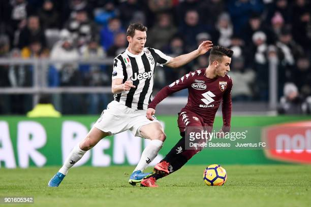 Stephan Lichtsteiner and Tomas Rincon during the TIM Cup match between Juventus and Torino FC at Allianz Stadium on January 3 20