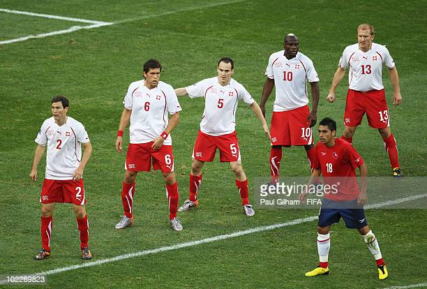 Stephan Lichtsteiner Benjamin Huggel Steve von Bergen Blaise Nkufo and Stephane Grichting of Switzerland and Gonzalo Jara of Chile look on during the...