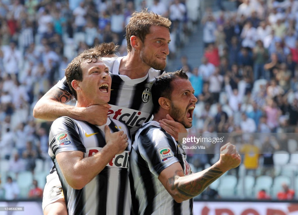 Stephan Lichtsteiner, Claudio Marchisio and Simone Pepe of Juventus FC celebrates scoring the second goal during the Serie A match between Juventus FC v Parma FC at Juventus Stadium on September 11, 2011 in Turin, Italy.