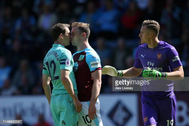 Stephan Lichtsteiner of Arsenal clashes with Ashley Barnes of Burnley during the Premier League match between Burnley FC and Arsenal FC at Turf Moor...