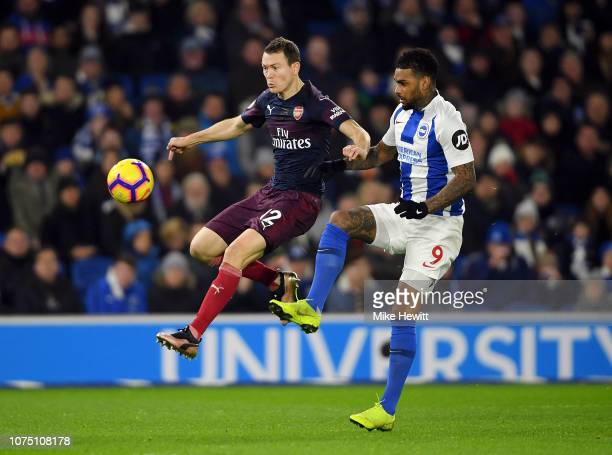 Stephan Lichtsteiner of Arsenal is challenged by Jurgen Locadia of Brighton Hove Albion during the Premier League match between Brighton Hove Albion...