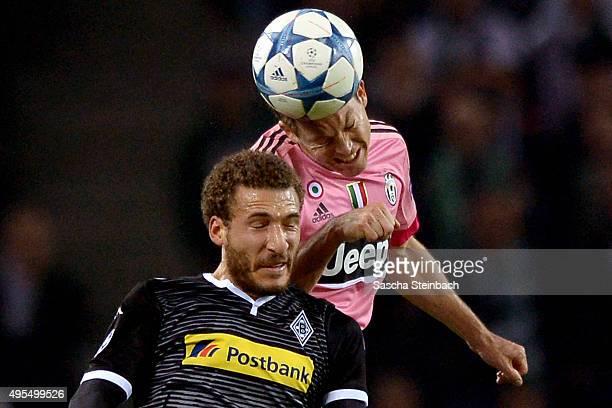 Stephan Lichtsteiner of Juventus and Fabian Johnson of Moenchengladbach battle for a header during the UEFA Champions League group stage match...