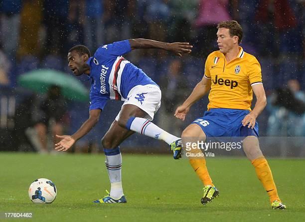 Stephan Lichtsteiner of Juventus and Pedro Obiang of UC Sampdoria compete for the ball during the Serie A match between UC Sampdoria and Juventus at...