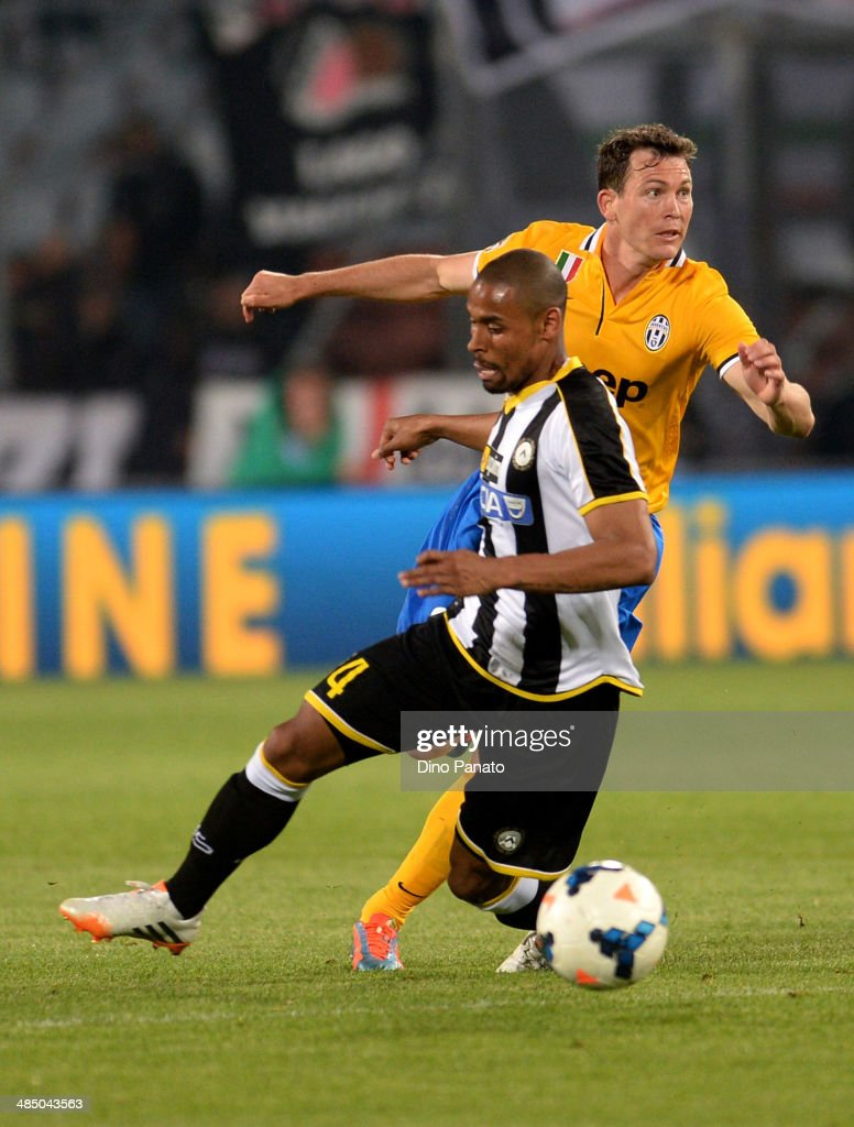 Stephan Lichtsteiner (L) of Juventus competes with Allan Marques Loureiro of Udinese Calcio during the Serie A match between Udinese Calcio and Juventus at Stadio Friuli on April 14, 2014 in Udine, Italy.